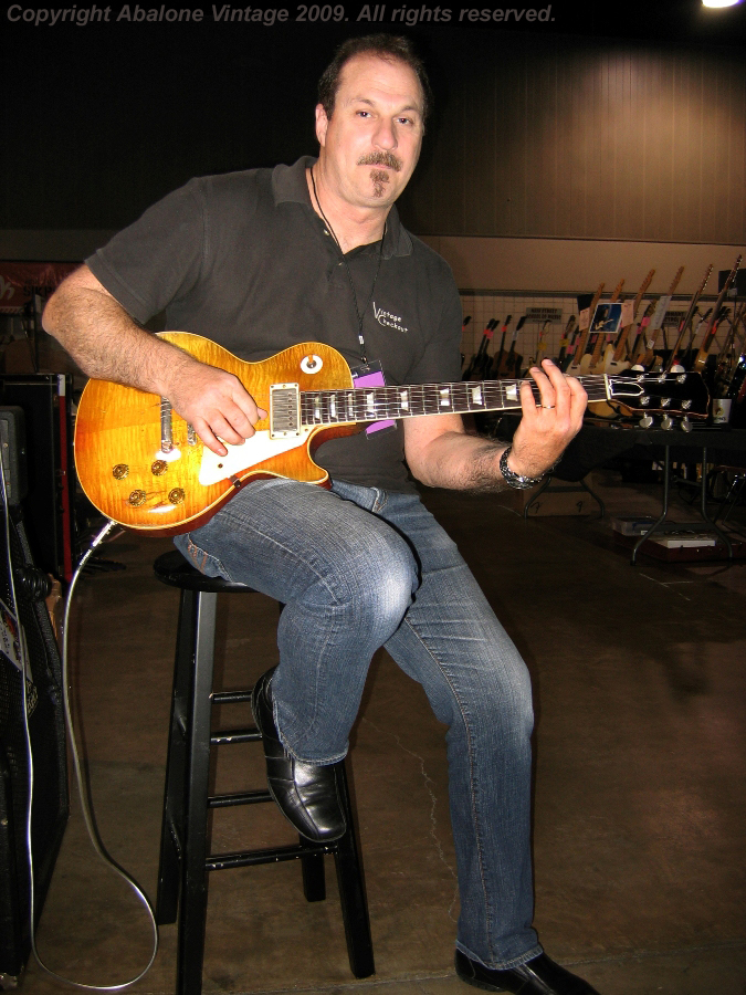 Tom Whitrock of Third Eye Music at the 1986 Dallas Guitar Show with a LOT  of '59 Les Pauls!